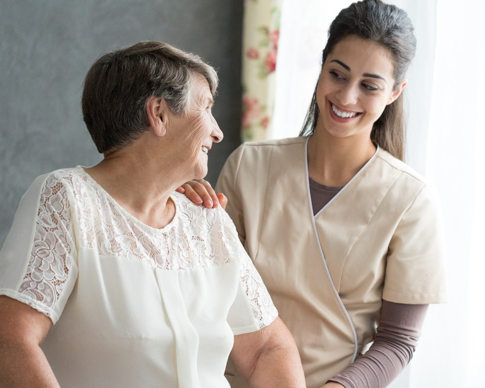 healthcare professional helping senior woman