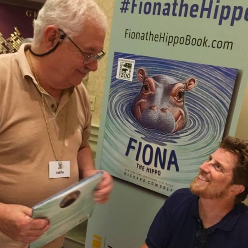 author selling his book to a man
