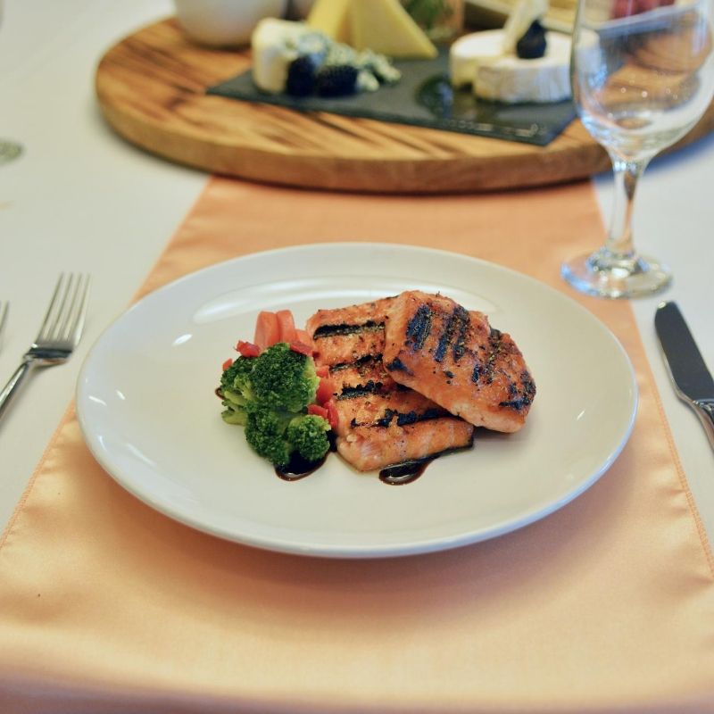 salmon on plate with vegetables