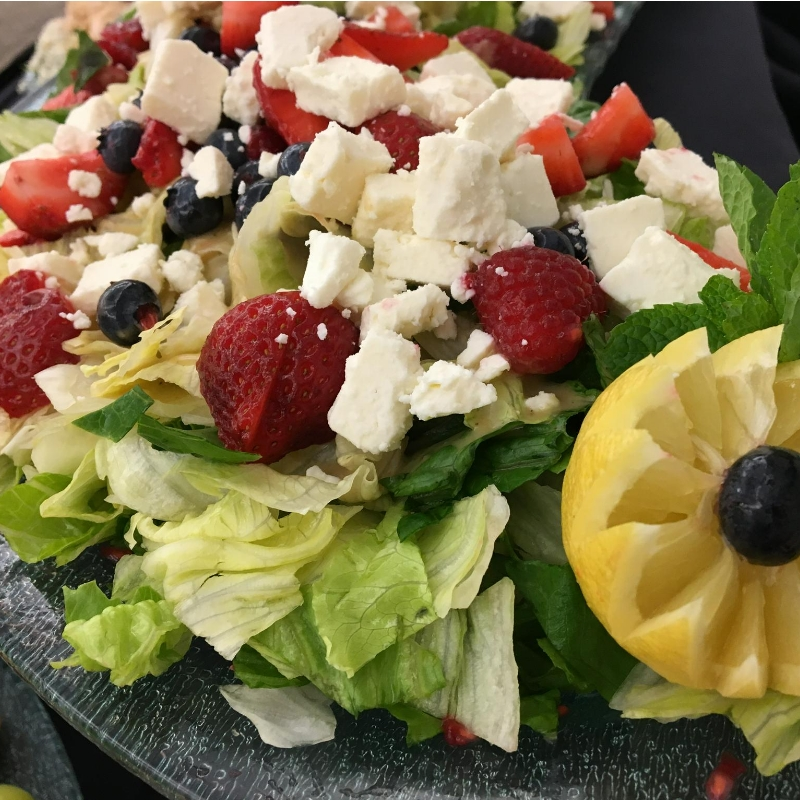 fruit and chicken salad on a bed of lettuce