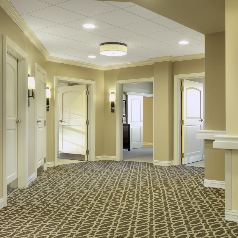 hallway with doors in nursing faciltiy