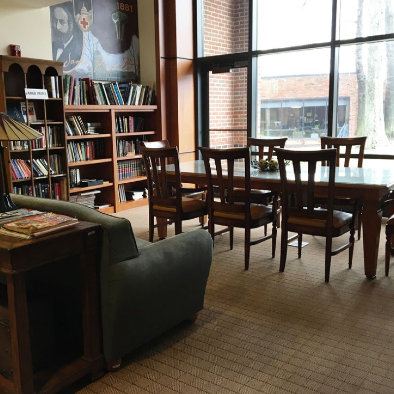 library with bookshelves and table and chairs