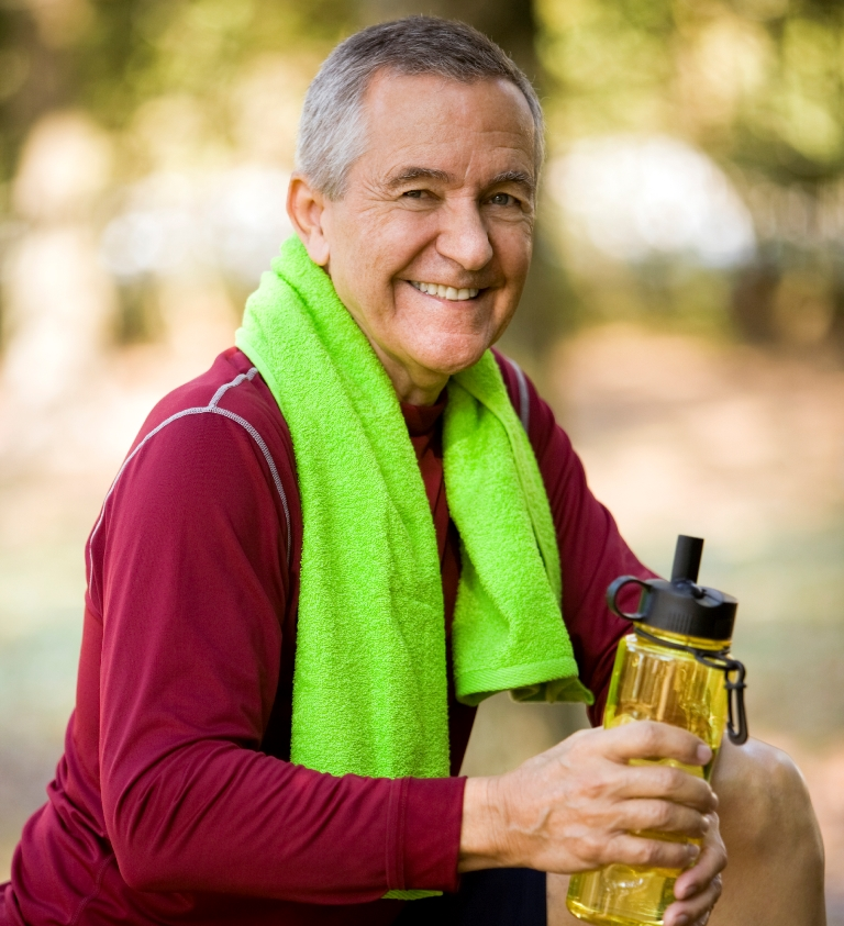 senior man smiling after a workout in the park