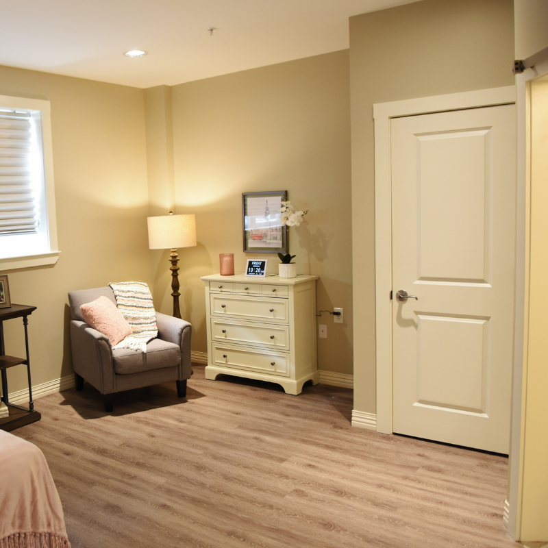bedroom with seating area and dresser