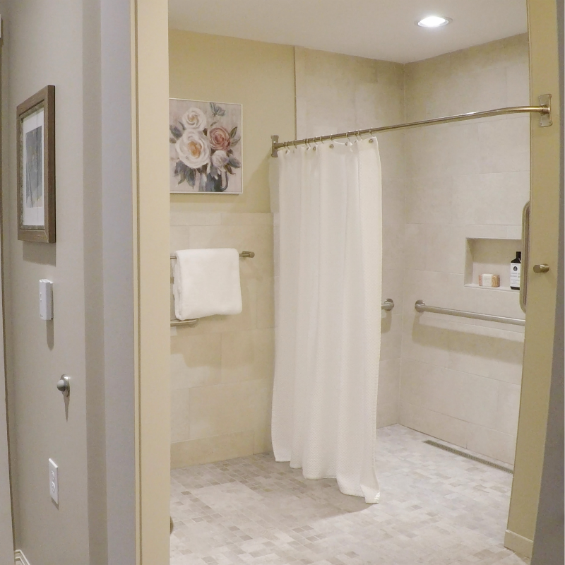 white tiles shower with accessible entry